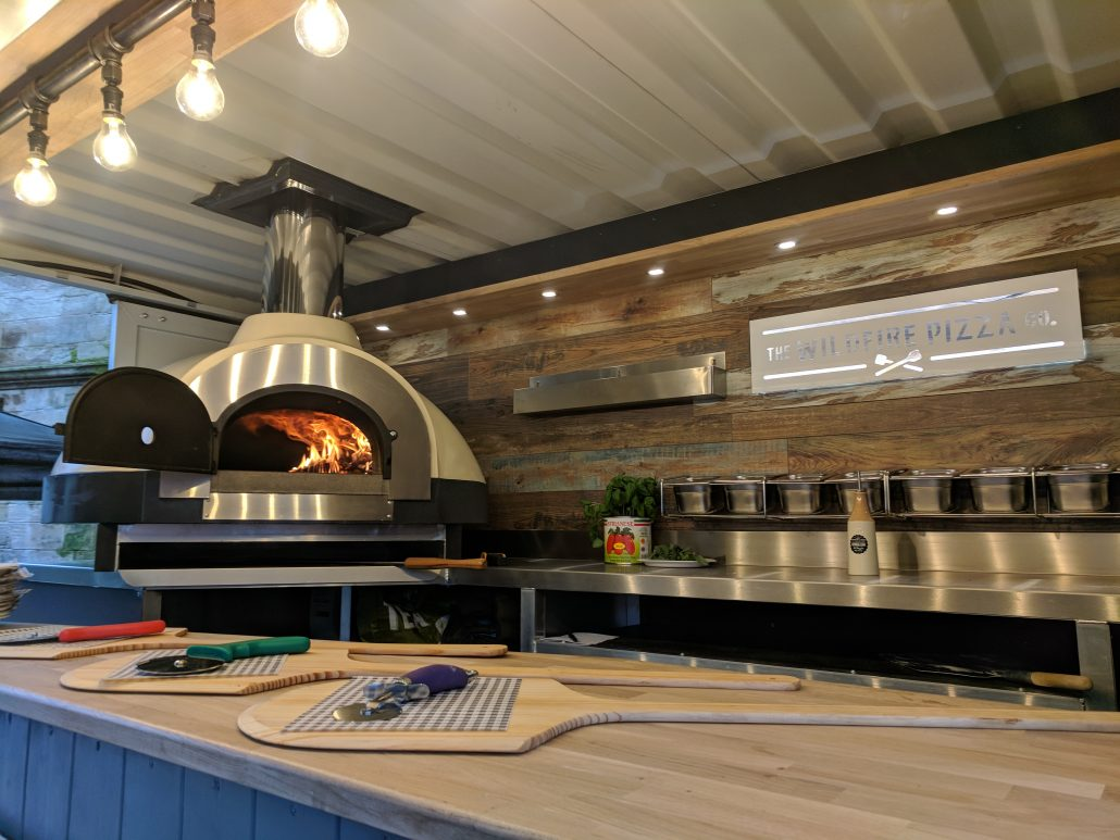 All fired up and ready to go! Mobile wood fired pizza cooked in style